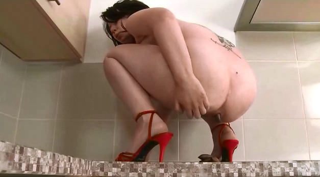Sexy brunette covering her body with shit - 4